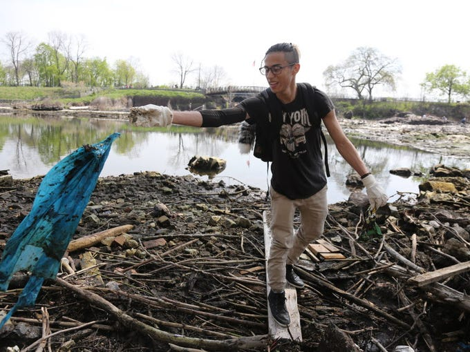 Surrounded on three sides by water and sandwiched between two major cities, NJ has been in perfect position to be pummeled by plastic pollution. Miguel Cano clears plastic bags from debris that collects along the Passaic River in Paterson in 2016.