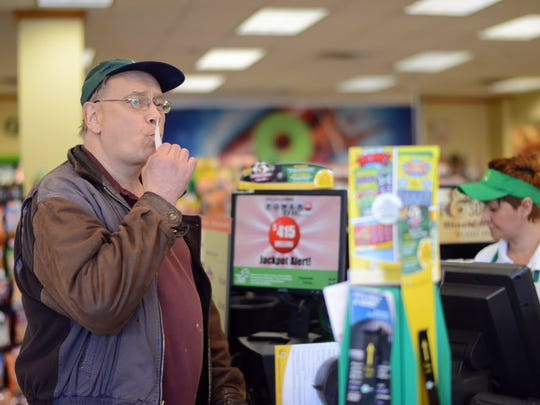 Fred Zott, of River Edge, kisses the Powerball ticket that he bought at the Quick Chek in Hackensack for good luck on Saturday, May 7, 2016.