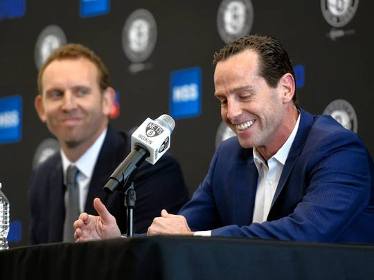 Brooklyn Nets general manager Sean Marks (left) and coach Kenny Atkinson have rebuilt the Nets.