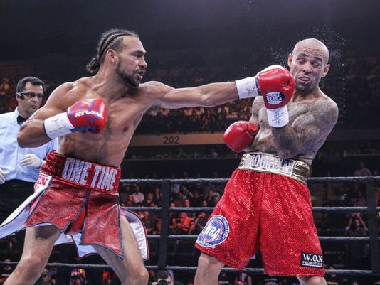 Keith Thurman wins when cut forces Luis Collazo's corner to stop fight