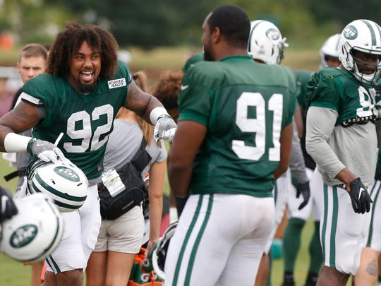 New York Jets defensive tackle Leonard Williams  jokes with teammates during a joint practice with the Washington Redskins at Bon Secours Washington Redskins Training Center. (Geoff Burke-USA TODAY Sports)