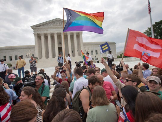 The crowd reacts as the ruling on same-sex marriage was announced outside of the Supreme Court in Washington, Friday June 26, 2015. The Supreme Court declared that same-sex couples have a right to marry anywhere in the US, but a Tennessee law seeks to undo that ruling in the state.