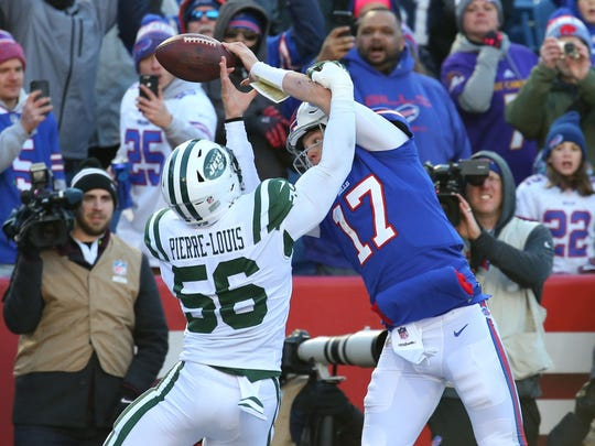 New York Jets linebacker Kevin Pierre-Louis (56) breaks up a pass in the end zone intended for Buffalo Bills quarterback Josh Allen (17) during the second quarter at New Era Field. (Rich Barnes-USA TODAY Sports