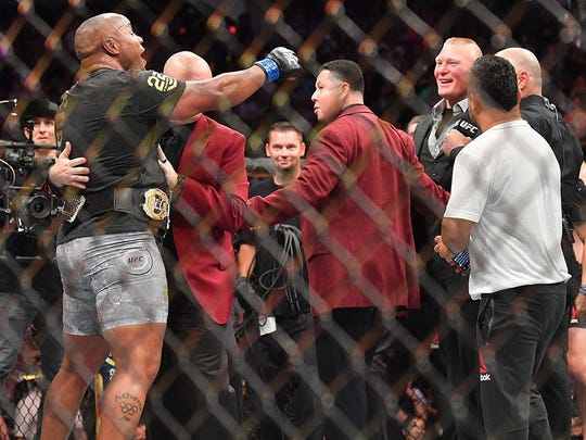 Daniel Cormier (left) and Brock Lesnar (right) after UFC 226. (Getty Images)