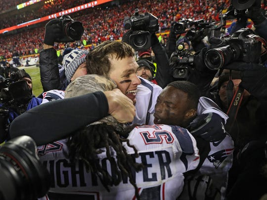 Tom Brady, 41, with Dont'a Hightower, 28, and Keion Crossen, 22. (Photo by Patrick Smith/Getty Images)