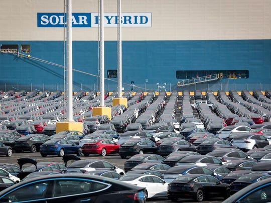 Tesla Inc. vehicles sit in a parking lot of a port before shipment.
