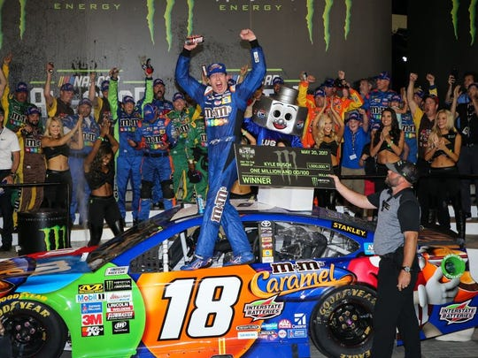 Kyle Busch celebrates after winning the 2017 NASCAR All-Star Race. (Jim Dedmon, USA TODAY Sports)