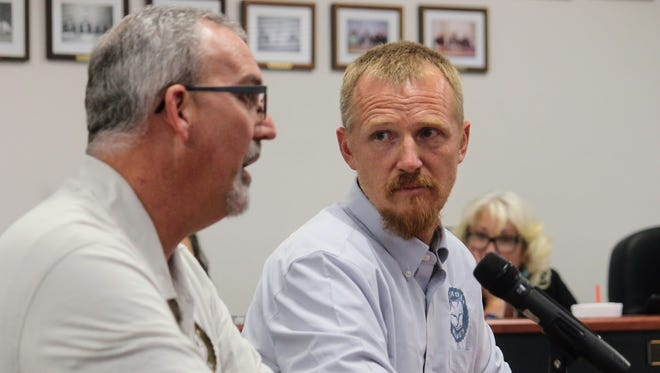 Foxhole Homes President Darron Williams speaks to Otero County Commissioners regarding the proposed community for homeless veterans Thursday while Foxhole Homes founder Ted Brinegar looks on.
