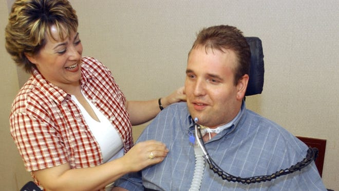 Melissa Deicher talks with her husband, Matt, at a dinner hosted by Wausau Hospital for EMTs in observance of Emergency Medical Services Week in 2004.