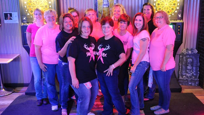 The Mansfield Pink Ladies Dart Team at The Backroom Bar play on Tuesday night. Pink Ladies dart leagues across the country are raising funds for the fight against breast cancer through dart games, bake sales, benefit events and fishing derbies with 100 percent of the proceeds going to organizations that support breast cancer awareness and individuals fighting breast cancer.