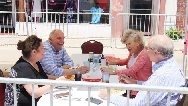 Tourism Director Ellie Alexander, far left, and City Administrator Bob Karls, far right, dine with Ron Selle, second from left, and Darlene Agner at Madison Street Family Restaurant Monday afternoon. Selle and Agner represent Selle-Agner Exhibits, which is involved with the Strevell House in Pontiac.