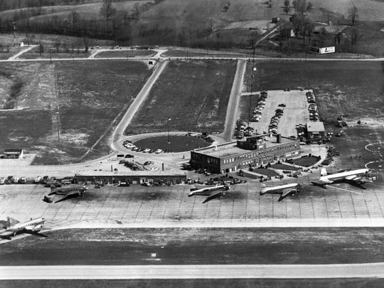 In a 1954 photo, propeller-driven passenger planes await instructions from the control tower atop the terminal building at Greater Cincinnati Airport, now known as Cincinnati/Northern Kentucky International Airport.