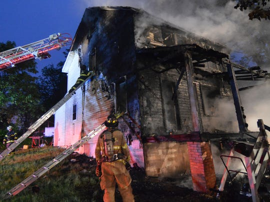 Nine area fire companies battle a fire Tuesday morning in Christiana that heavily damaged a home on North Old Baltimore Pike.
