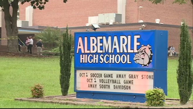 Police investigate after a shooting Sept. 30, 2014, at Albemarle High School in Albemarle, N.C.