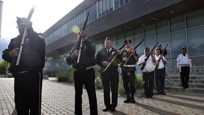 Metro Vets members fire a rifle salute during the Sept. 11 Community Commemoration Ceremony at the St. Cloud police station in 2014.
