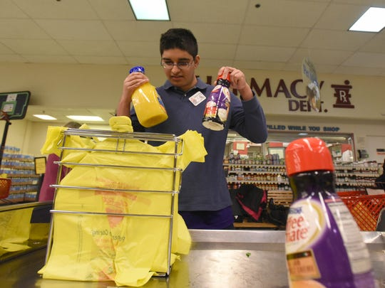 Pascack Valley Regional High School student A.J. Velagala bags groceries at the ShopRite in Hillsdale.