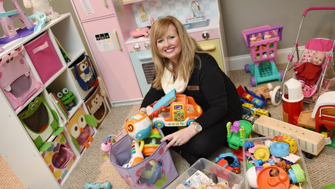 Diane Ryan, a professional organizer, works her magic in the playroom of a client's home in Madison's Reunion neighborhood.