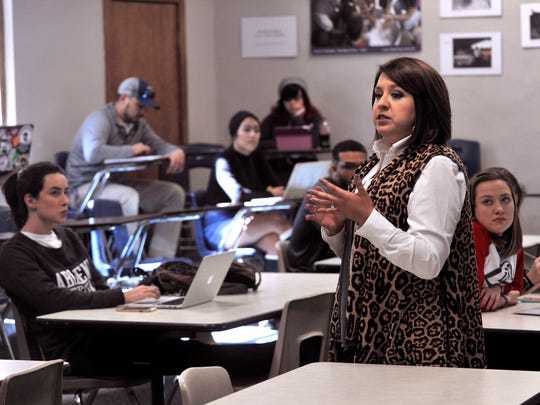Kristina Campos Davis teaches a class on Social Theory at Abilene Christian University. She is the first ethnic minority to be president of the Junior League of Abilene.