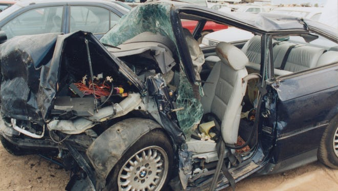 Jim and Dorothy Valcarcel's BMW sedan after they were hit in a head-on car crash on Interstate 10 at 51st Avenue in Phoenix.