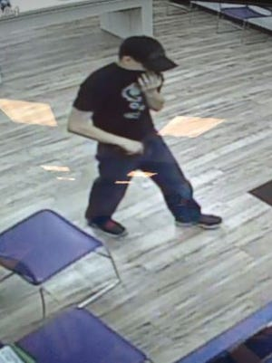 Police are trying to identify this man who they say robbed a Metro PCS near Newark.