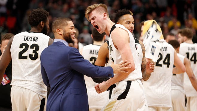 Purdue Boilermakers forward Matt Haarms (32) reacts to defeating against the Butler Bulldogs in the second round of the 2018 NCAA Tournament at Little Caesars Arena.