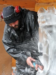 Jeff Meyers of Elegant Ice sculpts a horse during the