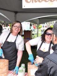 Provost Sally McRorie serves ice cream to students