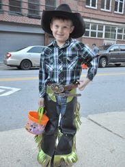 A smiling cowboy stocks up on snacks before riding
