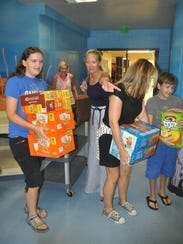 Teachers and parents volunteered to pack snack bags