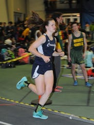 Morris Catholic distance runner Molly Whelan competes