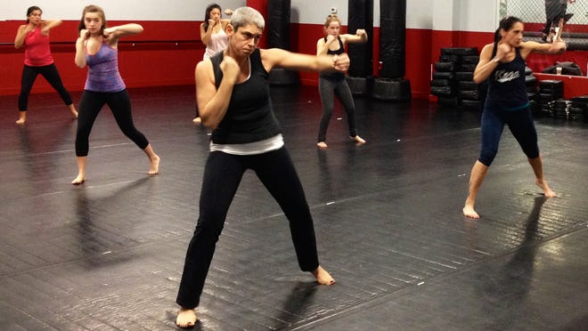 Victoria Goodman does Koga, a program that fuses the techniques and mindsets of kickboxing and yoga, at Westchester Mixed Martial Arts & Fitness in Mount Kisco.