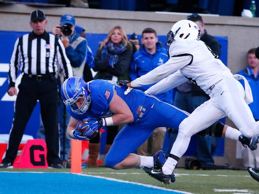 Air Force tight end Garrett Griffin (80) dives into the end zone for a touchdown against Army defensive back Tevin Long (8) during the second half of an NCAA college football game at Air Force Academy, Colo., Saturday, Nov. 7, 2015. (AP Photo/Jack Dempsey)