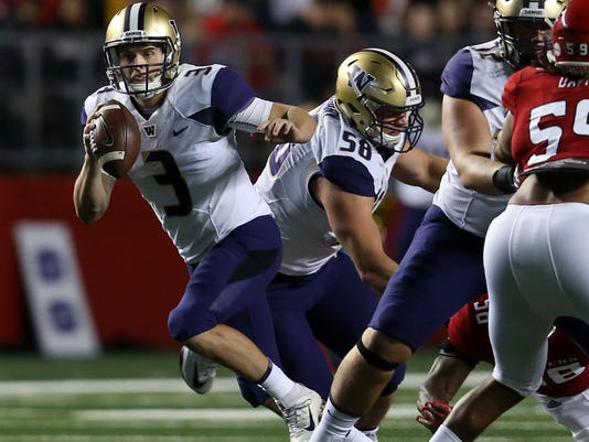Washington quarterback Jake Browning (3) looks to pass during the first half of an NCAA college football game against Rutgers, Friday, Sept. 1, 2017, in Piscataway, N.J. (AP Photo/Mel Evans)