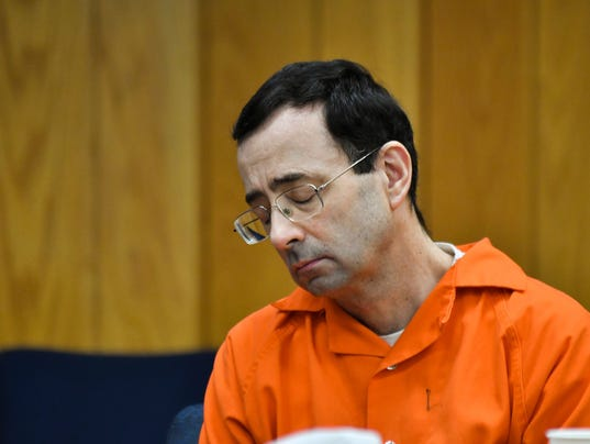 Larry Nassar case: A dad rushes Nassar, 'Give me one ...