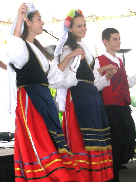 Three dancers of the Holy Spirit Youth Dancers perform at the 2014 Greek Fest.