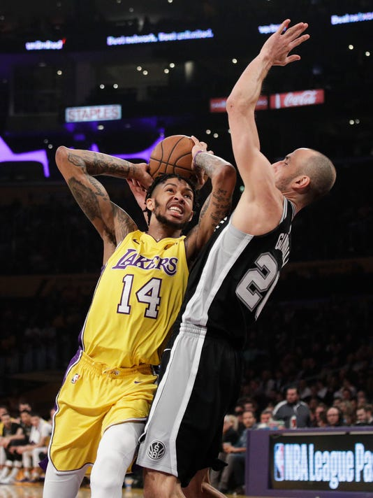 Los Angeles Lakers' Brandon Ingram, left, is pressured by San Antonio Spurs' Manu Ginobili, of Argentina, during the first half of an NBA basketball game Thursday, Jan. 11, 2018, in Los Angeles. (AP Photo/Jae C. Hong)