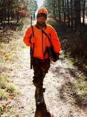 Greg Boley walks back into the woods in hopes of seeing