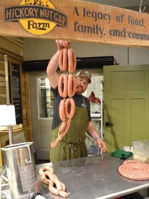 Craig Deihl shows off a string of handmade sausages.