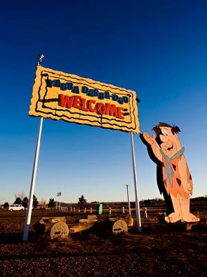 A 'Yabba Dabba Doo' greets fans at the entrance of the property.