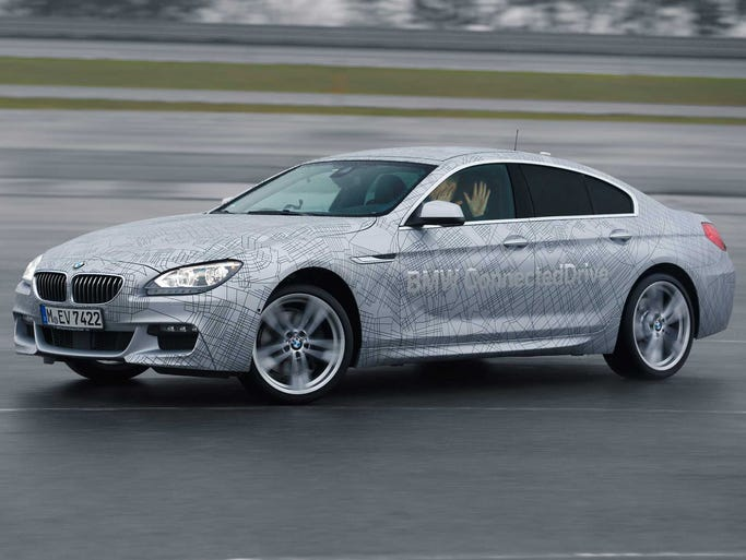 A BMW is put though its paces at test track where a safety system that takes over control of the car in skids is tested