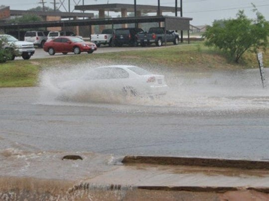The Southwest Boulevard crossing floods after heavy rains in the early summer of 2012.