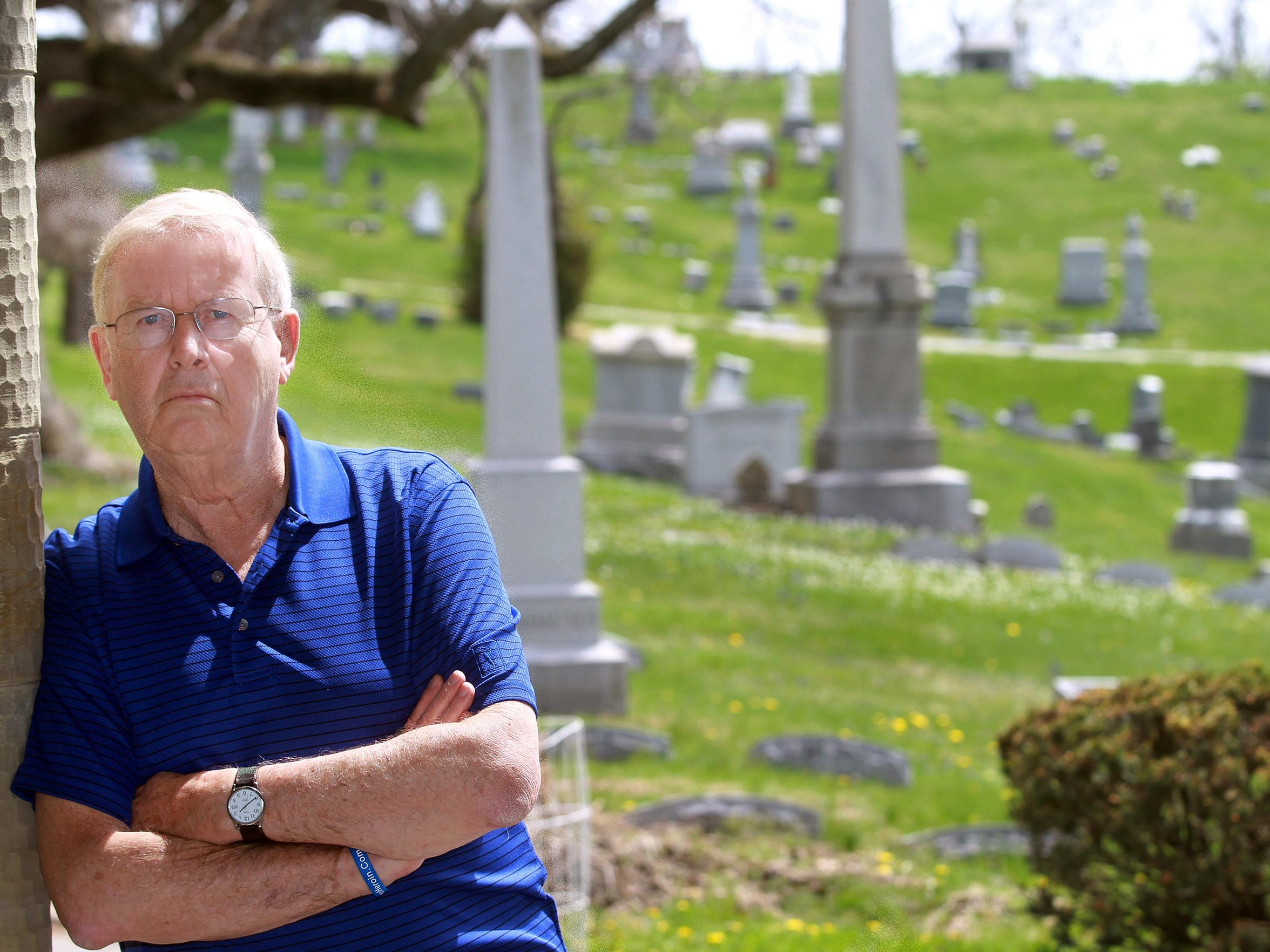 Noel Stegner of Fort Thomas stands in Evergreen Cemetery