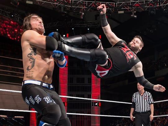 Kevin Owens drop-kicking  AJ Styles.