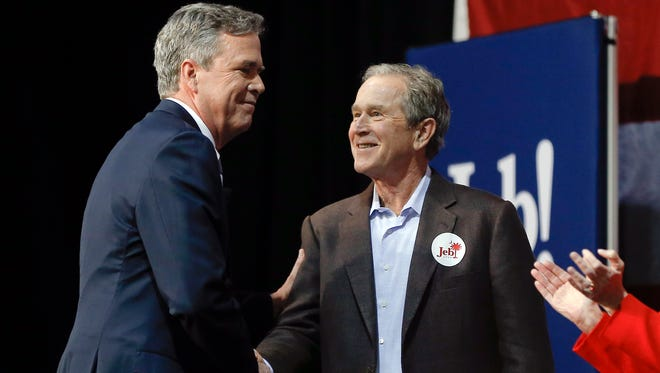 Republican presidential candidate and former Florida Gov. Jeb Bush, left, shakes hands with his brother former President George W. Bush during a campaign stop Monday, Feb. 15, in North Charleston, S.C.