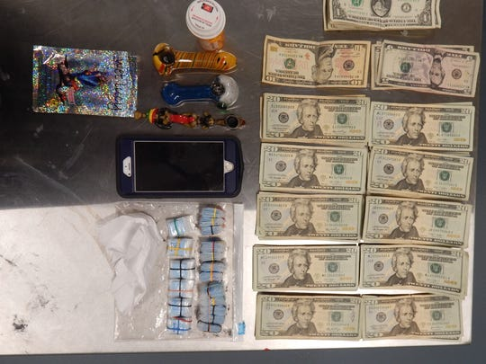 State police seized more than 250 bags of heroin and more than $1,000 in suspected drug proceeds from the Magnolia home.