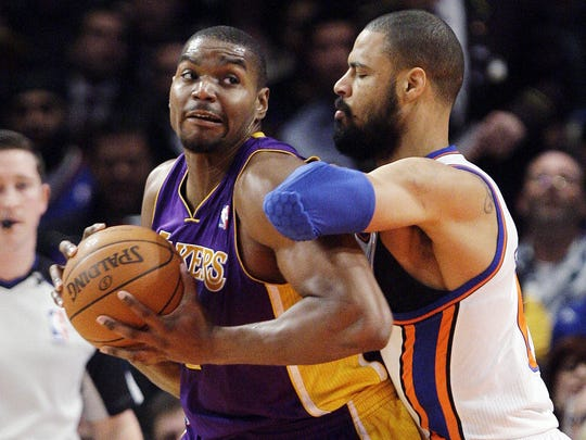 The Lakers' Andrew Bynum (left) posts up the Knicks' Tyson Chandler during a 2012 game.