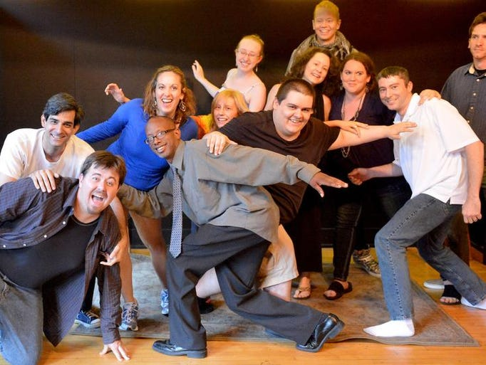 """Performing students and actors participate in a group exercise called """"stage picture"""" during a comedy class at the Groove Cat Lounge in Staunton on Monday, June 3, 2013."""