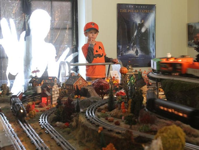 Noah Millaro, 7, of White Plains, watches the trains go around at the House on Haunted Hill Train Show at Lasdon Park in Somers Oct. 12, 2013.