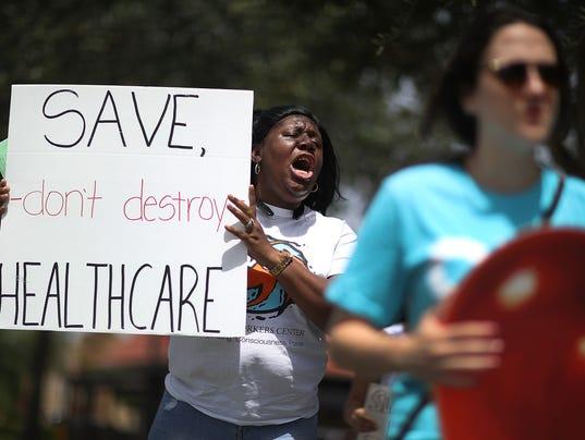 Activists Protest Healthcare Vote Of GOP Rep. Carlos Curbelo In Miami