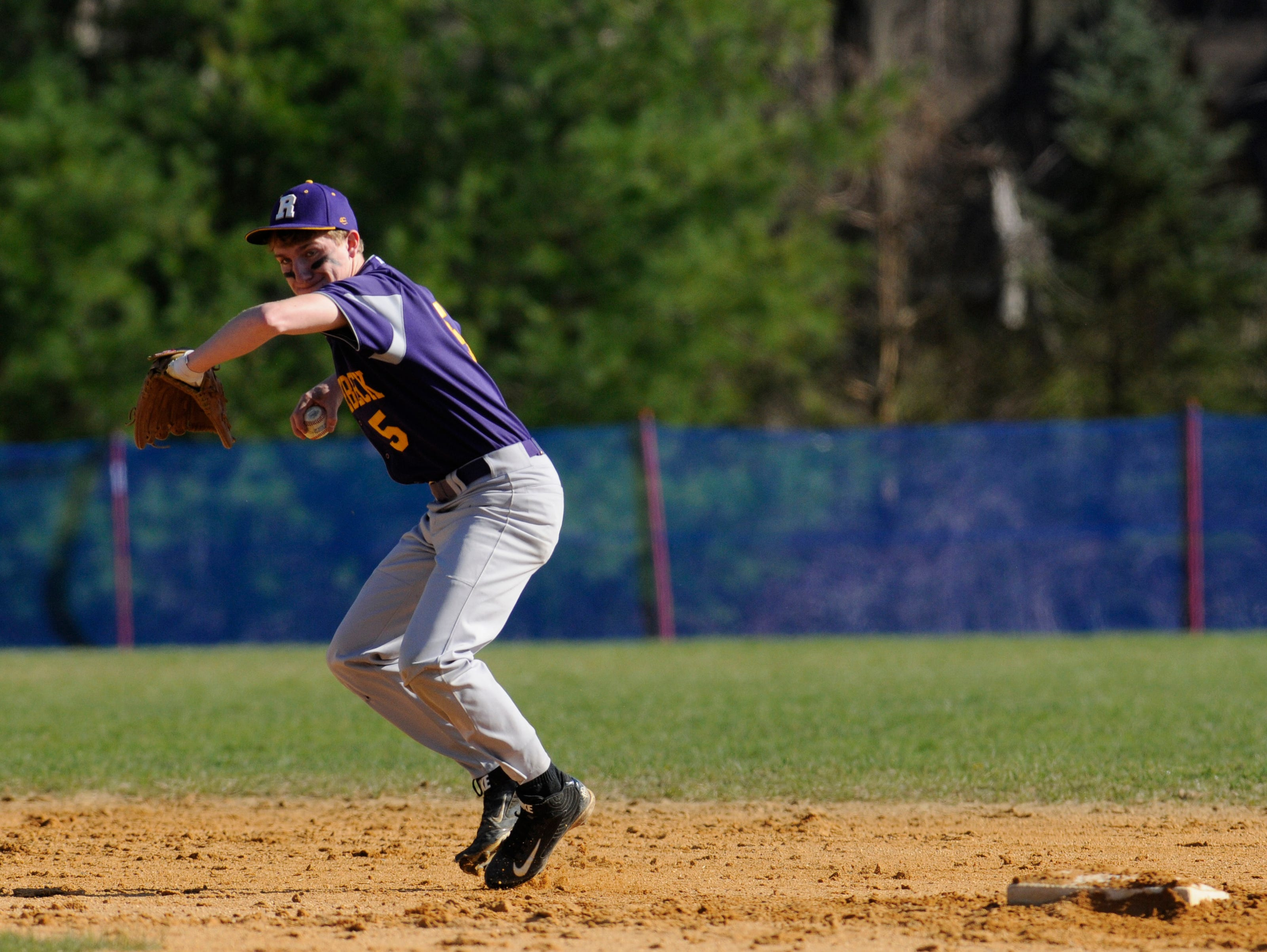 Rhinebeck's Ryan Euell recovers an infield hit during Wednesday's home game versus Webutuck.